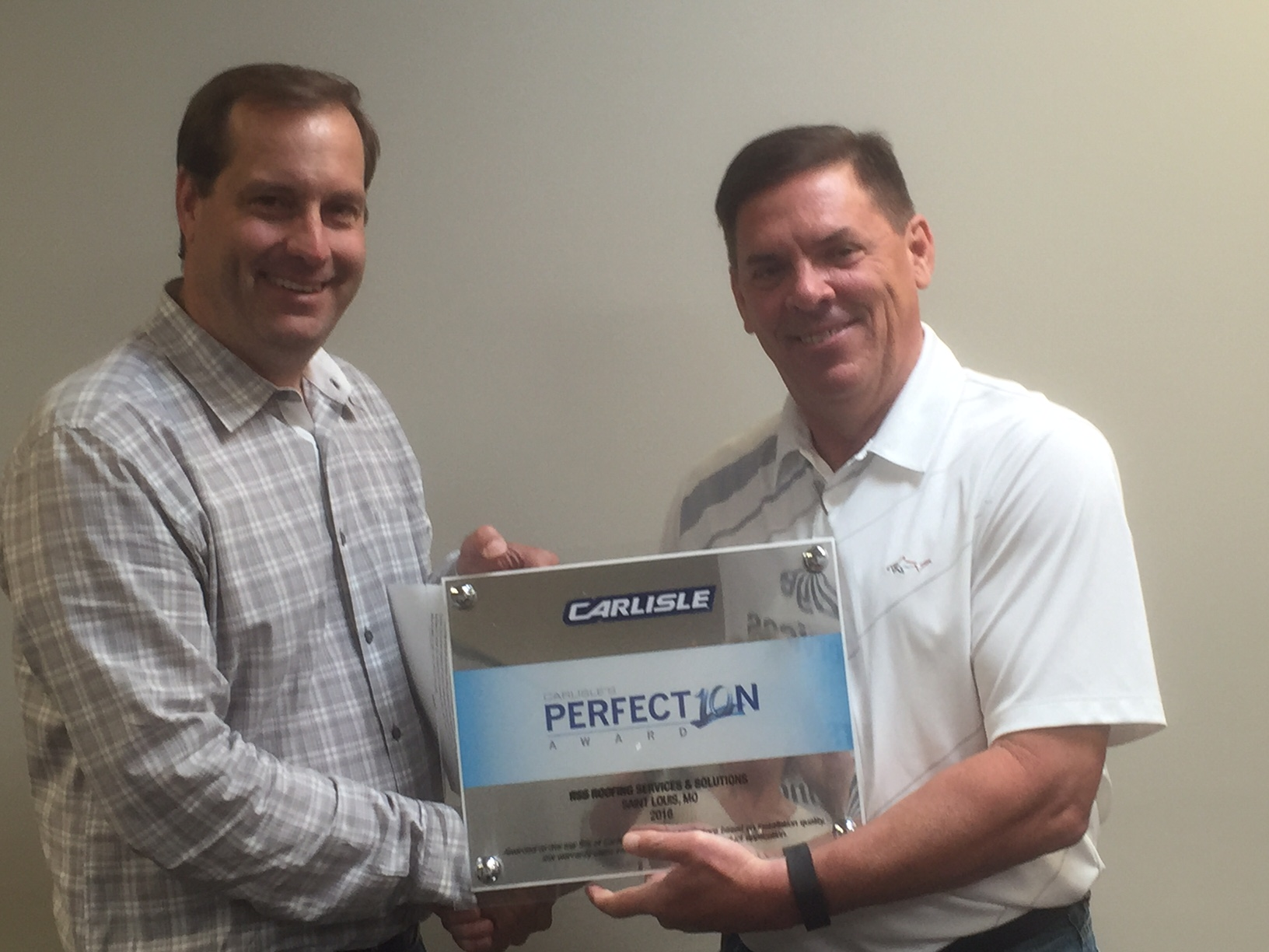 Joe Lauberth, with Roofing Services & Solutions (RSS) of St. Louis, Missouri received Carlisle's Perfection Award from Greg Luna, President of Luna and Associates.