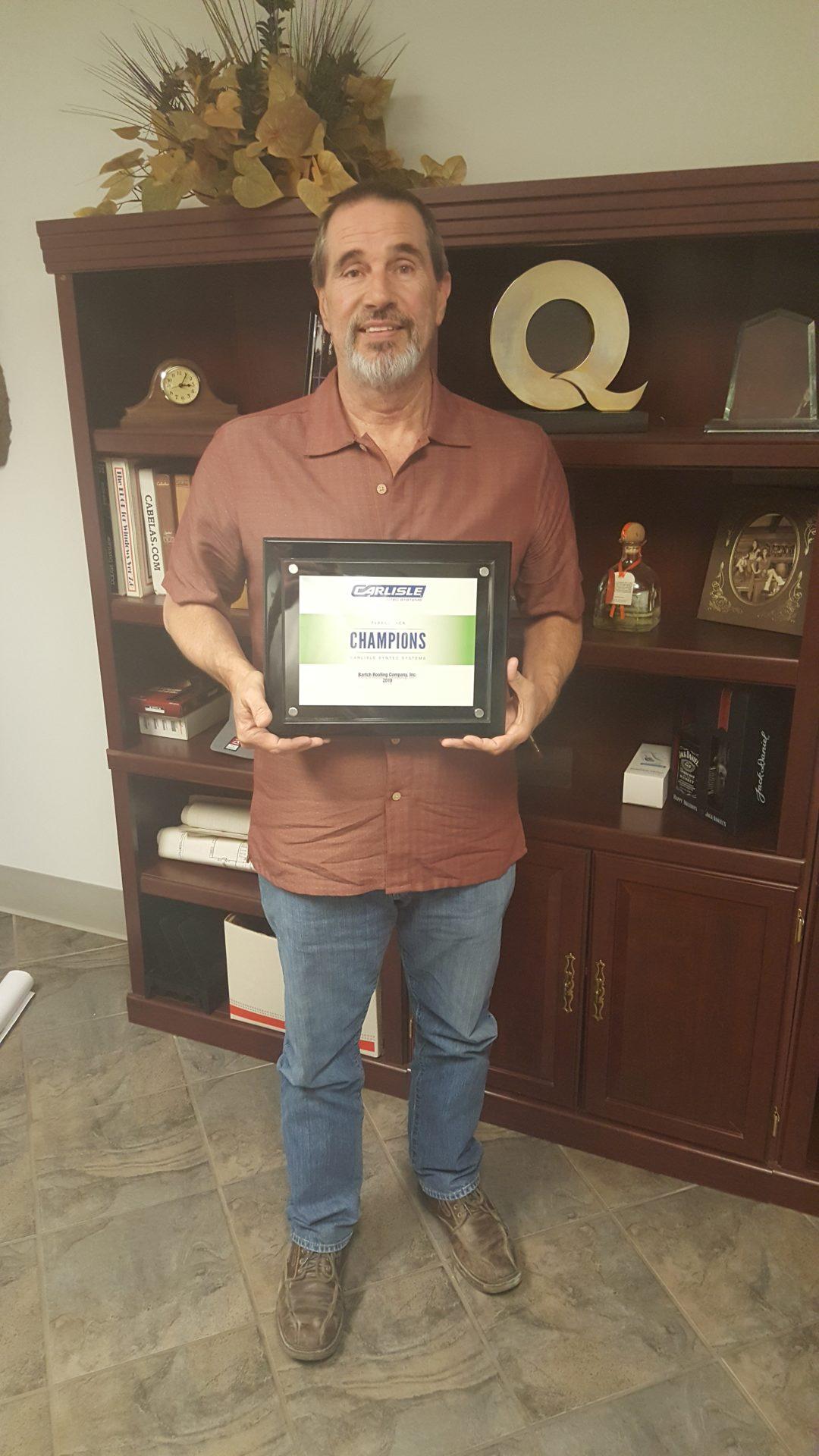 Bartch Roofing Receives Carlisle FleeceBACK Award